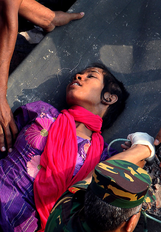 . Survivor Reshma Begum lies on a stretcher after being pulled out from the rubble of a building that collapsed in Savar, near Dhaka, Bangladesh, Friday, May 10, 2013. (AP Photo)