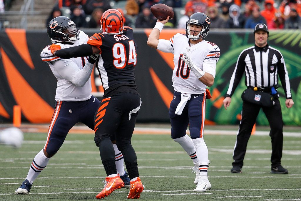 . Chicago Bears quarterback Mitchell Trubisky (10) passes under pressure from Cincinnati Bengals defensive end Chris Smith (94) in the first half of an NFL football game, Sunday, Dec. 10, 2017, in Cincinnati. (AP Photo/Frank Victores)