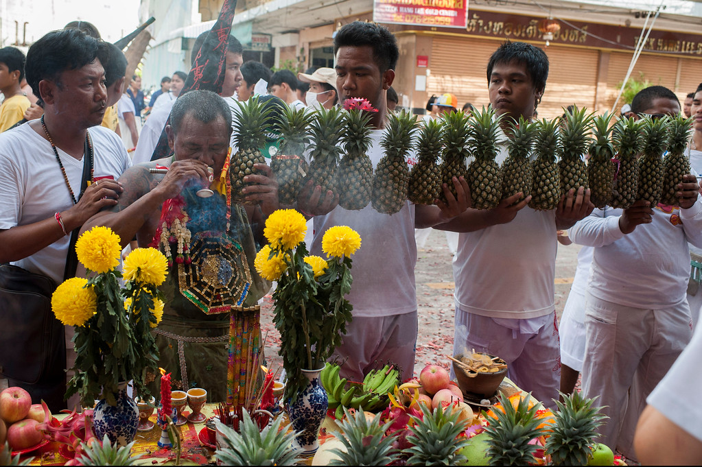 . A vegetarian festival devotee drinks as he bless Thai people during a parade through the streets on September 29, 2014 in Phuket, Thailand.   (Photo by Borja Sanchez-Trillo/Getty Images)