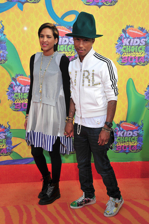 . Musician Pharrell Williams (R) and wife Helen Lasichanh attend Nickelodeon\'s 27th Annual Kids\' Choice Awards held at USC Galen Center on March 29, 2014 in Los Angeles, California.  (Photo by Frazer Harrison/Getty Images)