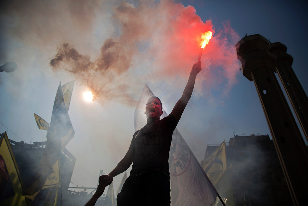 . A supporter of Egypt\'s ousted President Mohammed Morsi holds a flare and chants slogans against the army during a protest in Cairo, Egypt, Friday, Oct. 11, 2013. Supporters of ousted president Mohammed Morsi are holding scattered protests across Egypt, calling off a planned rally at Cairo\'s iconic Tahrir Square almost a week after bloody clashes left nearly 60 dead. Thousands of Morsi supporters took to the streets Friday in several cities, commemorating 100 days since Egypt\'s first democratically elected president was ousted by the military following mass protests calling for his resignation. (AP Photo/Hassan Ammar)