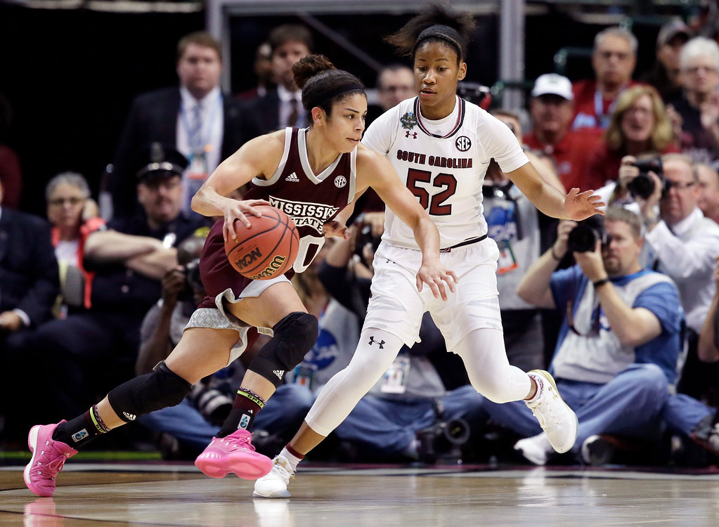 . Mississippi State guard Dominique Dillingham (00) drives around South Carolina guard Tyasha Harris (52) during the first half in the final of NCAA women\'s Final Four college basketball tournament, Sunday, April 2, 2017, in Dallas. (AP Photo/LM Otero)