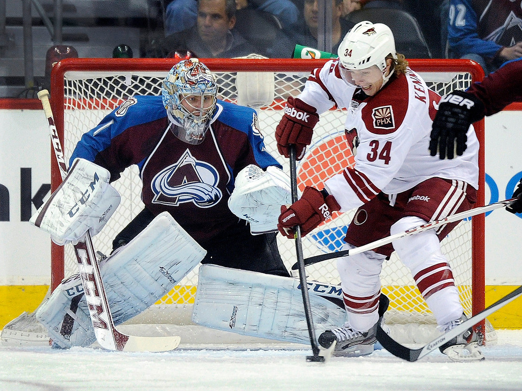 . Phoenix wing Tim Kennedy (34) looked for an opening to get the puck past Avs goalie Semyon Varlamov (1) in the first period.   Photo By Karl Gehring/The Denver Post