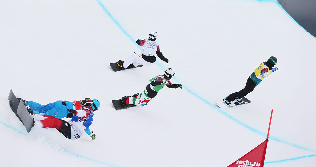 . Markus Schairer (blue pants) of Austria collides with Robert Fagan of Canada during the 1/8 final runs in the Menës Snowboard Cross at Rosa Khutor Extreme Park at the Sochi 2014 Olympic Games, Krasnaya Polyana, Russia, 18 February 2014.  EPA/SERGEY ILNITSKY