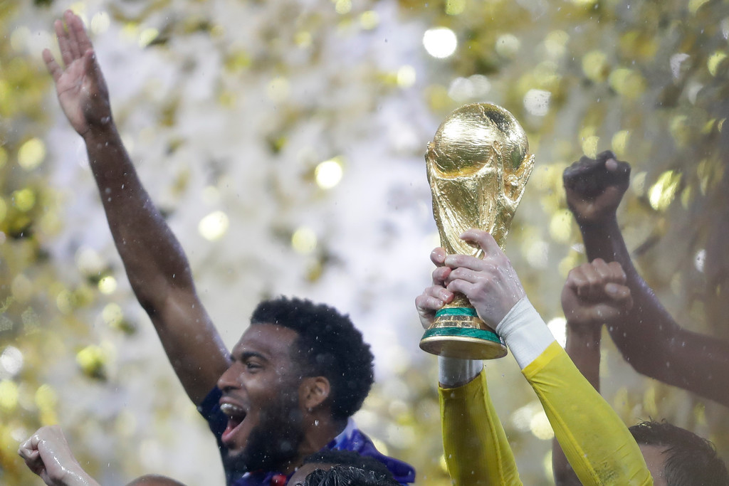 . France goalkeeper Hugo Lloris holds the trophy after winning the final match against Croatia at the 2018 soccer World Cup in Moscow, Russia, Sunday, July 15, 2018. (AP Photo/Natacha Pisarenko)