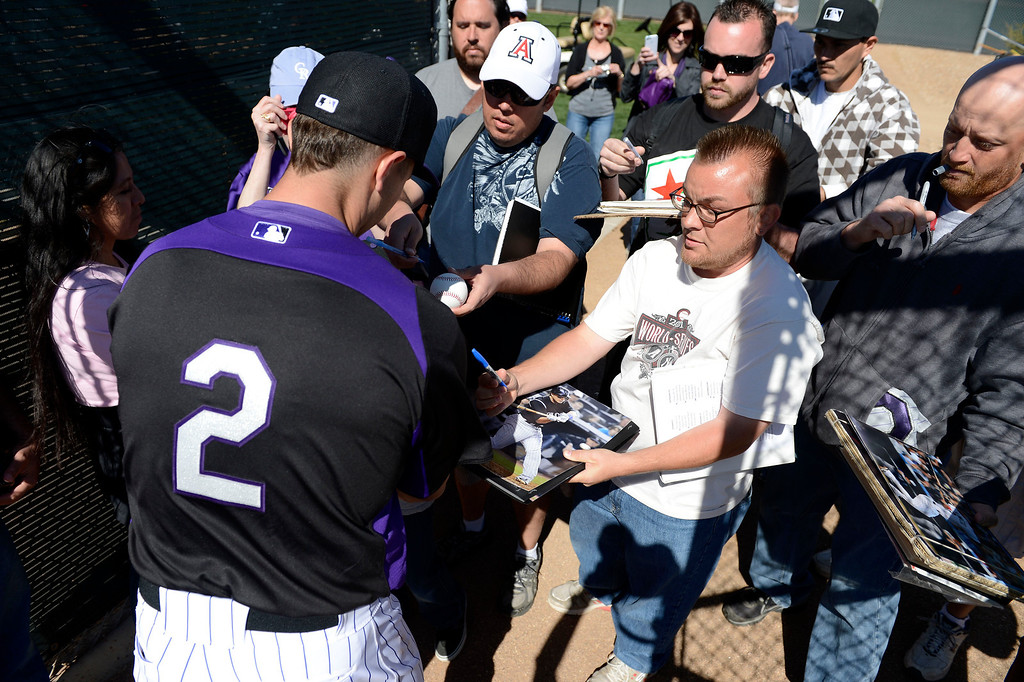 . SCOTTSDALE, AZ. - FEBRUARY 19: Colorado Rockies Troy Tulowitzki (2) signs autographs for fans during practice at Spring Training February 19, 2013 in Scottsdale. (Photo By John Leyba/The Denver Post)