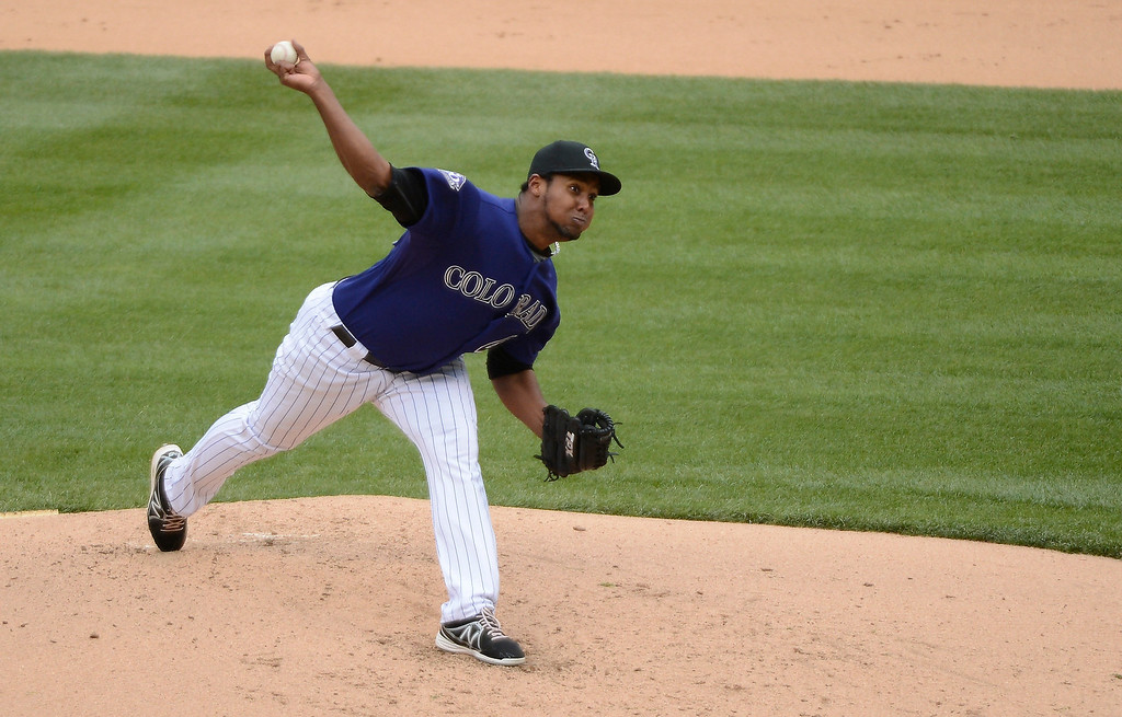 . Juan Nicasio of Colorado Rockies delivers a pitch against the New York Mets in the third inning April 16, 2013 at Coors Field. Both teams wore the number 42 on their jersey in honor of Jackie Robinson. (Photo By John Leyba/The Denver Post)