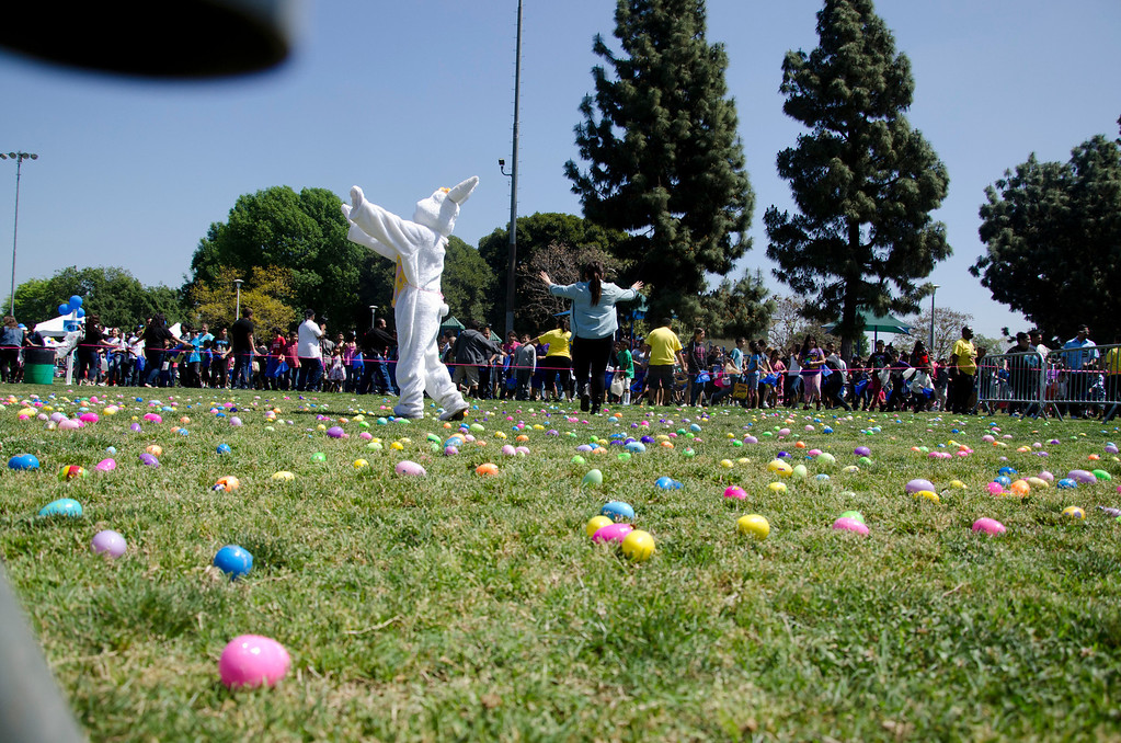 . Volunteers try to control a crowd of children at Easter Land, hosted by Los Angeles County Parks and Recreation and Freedom Christian Center at Mayberry Park in South Whittier, Calif., Saturday, March 20, 2013. An expected crowd of 2,000 guest more than doubled for a helicopter drop of 5,000 Easter eggs. (SGVN/Correspondent photo by Anibal Ortiz)