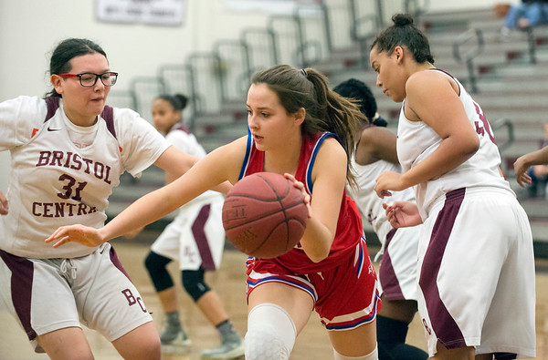 01/10/20 Wesley Bunnell | StaffrrThe Bristol Central girls basketball team was defeated at home on Friday night by Berlin. Berlin's (20) dribbles against BC's Lia Roldan (31).