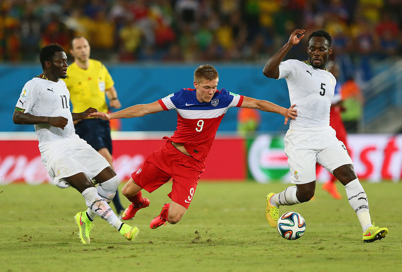 . NATAL, BRAZIL - JUNE 16: Aron Johannsson of the United States is challenged by Sulley Muntari (L) and Michael Essien of Ghana during the 2014 FIFA World Cup Brazil Group G match between Ghana and the United States at Estadio das Dunas on June 16, 2014 in Natal, Brazil.  (Photo by Kevin C. Cox/Getty Images)