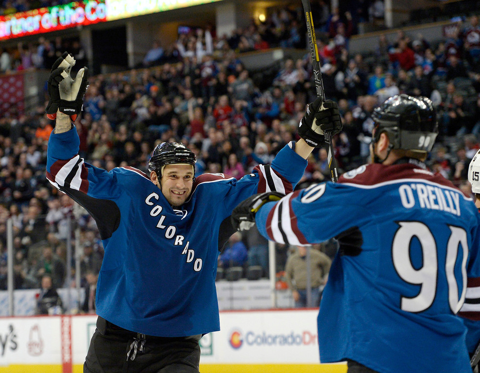 . Colorado Avalanche center Ryan O\'Reilly (90) celebrates his goal with Colorado Avalanche left wing Patrick Bordeleau (58) during the first period against the New Jersey Devils January 16, 2014 at Pepsi Center. (Photo by John Leyba/The Denver Post)