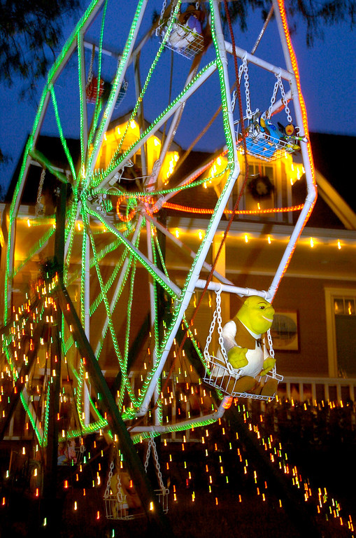 . NWS-XMAS-SH. DAILY BREEZE Photo by sean hiller.DEC. 23, 2005. Popular characters like Shrek ride a miniature ferris wheel at this holiday display in the Sleepy Hollow neighborhood of Torrance Friday evening.