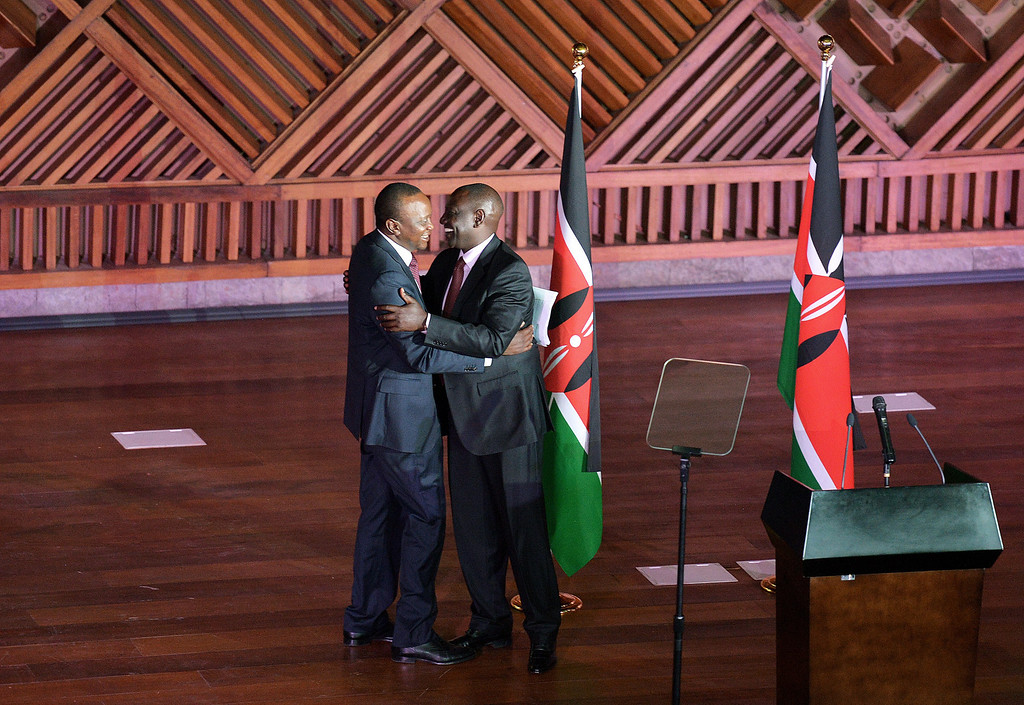 . Newly elected President Uhuru Kenyatta (L) hugs running mate William Ruto (R) after making a speech following his victory in Kenya\'s national elections in Nairobi on March 9, 2013. AFP PHOTO/ Carl  DE SOUZA/AFP/Getty Images
