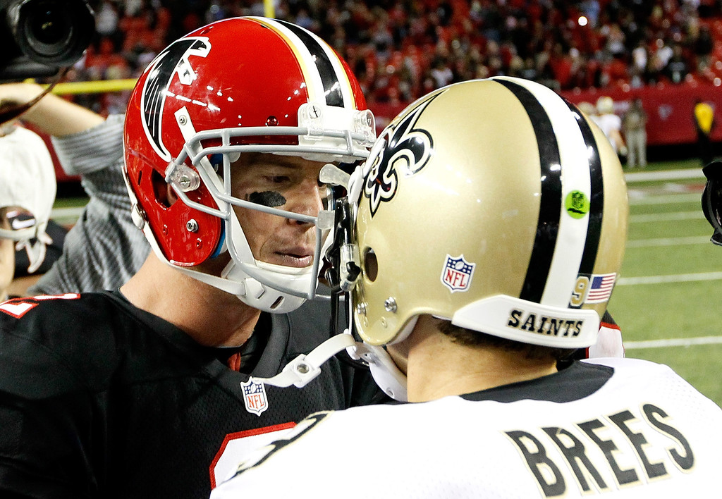 . ATLANTA, GA - NOVEMBER 29:  Matt Ryan #2 of the Atlanta Falcons shakes hands with Drew Brees #9 of the New Orleans Saints after their 23-13 win at Georgia Dome on November 29, 2012 in Atlanta, Georgia.  (Photo by Kevin C. Cox/Getty Images)