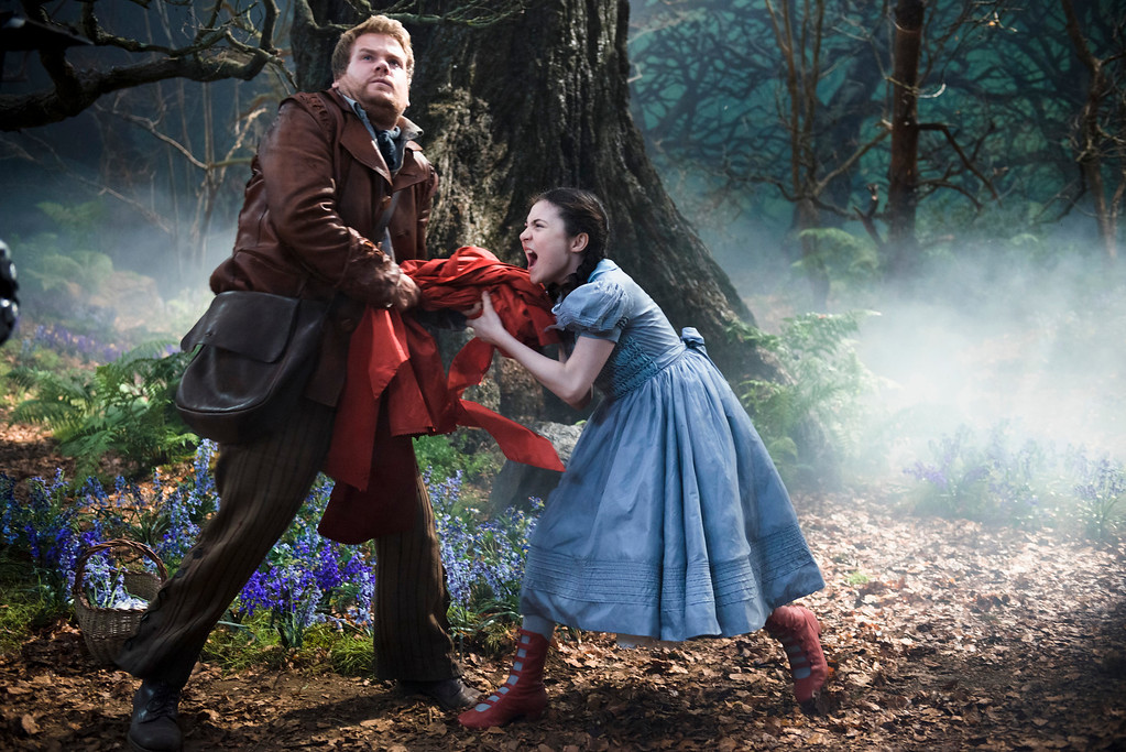 """. In this image released by Disney Enterprises, Inc., James Corden, left, and Lilla Crawford as Little Red Riding Hood appear in a scene from \""""Into the Woods.\"""" The film was nominated for a Golden Globe for best comedy on Thursday, Dec. 11, 2014. The 72nd annual Golden Globe awards will air on NBC on Sunday, Jan. 11. (AP Photo/Disney Enterprises, Inc., Peter Mountain)"""