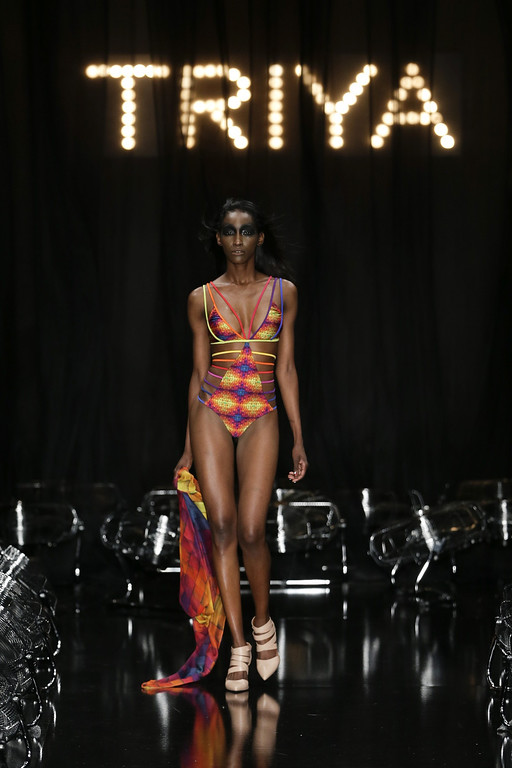 . A model wears a creation from the Triya collection during Fashion Week in Rio de Janeiro, Brazil, Friday, April 11, 2014. (AP Photo/Felipe Dana)