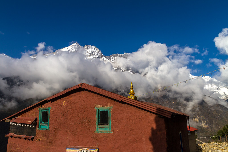 View of house with snowcapped mountain in background - Nepal