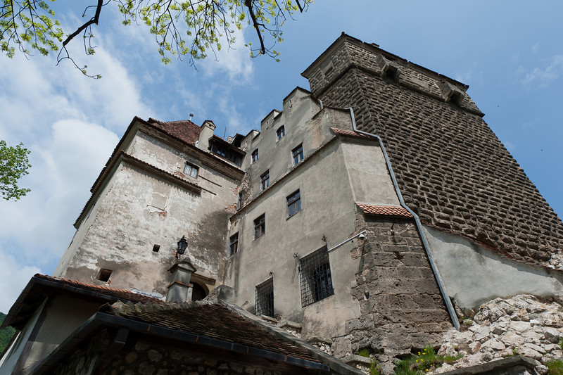 Looking up the walls of Bran Castle in Romania