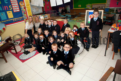First Days at School, Teacher Miss Mc Cartan,Classroom Assistant Ms Devine pictured with Primary 1 pupils at St Malachy's PS Carnagat Newry.