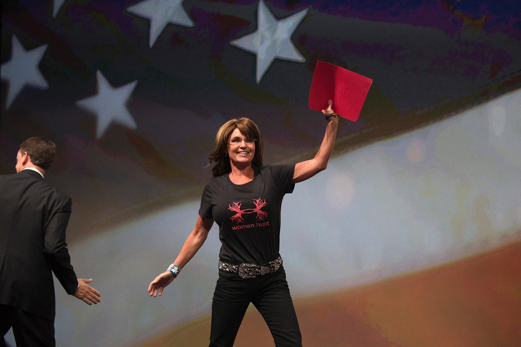 . Former Alaska Governor Sarah Palin waves as she enters the stage to speak during the NRA-ILA Leadership Forum at the George R. Brown Convention Center, the site for the National Rifle Association\'s annual meeting in Houston, Texas on May 3, 2013. President Barack Obama and national media are demonizing law-abiding gun owners in the wake of recent violent acts, National Rifle Association leaders and political allies said on Friday at its first convention since the Connecticut school massacre. Organizers expect some 70,000 attendees at the 142nd NRA Annual Meetings & Exhibits in Houston, which began on Friday and continues through Sunday.  REUTERS/Adrees Latif