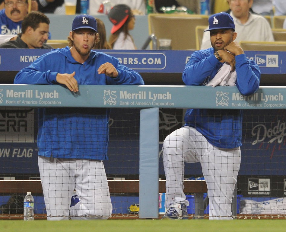 . Clayton Kershaw and Matt Kemp on the bench for the Dodgers. The Dodgers played the New York Mets in a game at Dodger Stadium in Los Angeles, CA. 8/13/2013(John McCoy/LA Daily News)