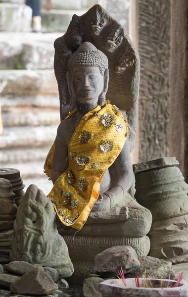 Small adorned statue