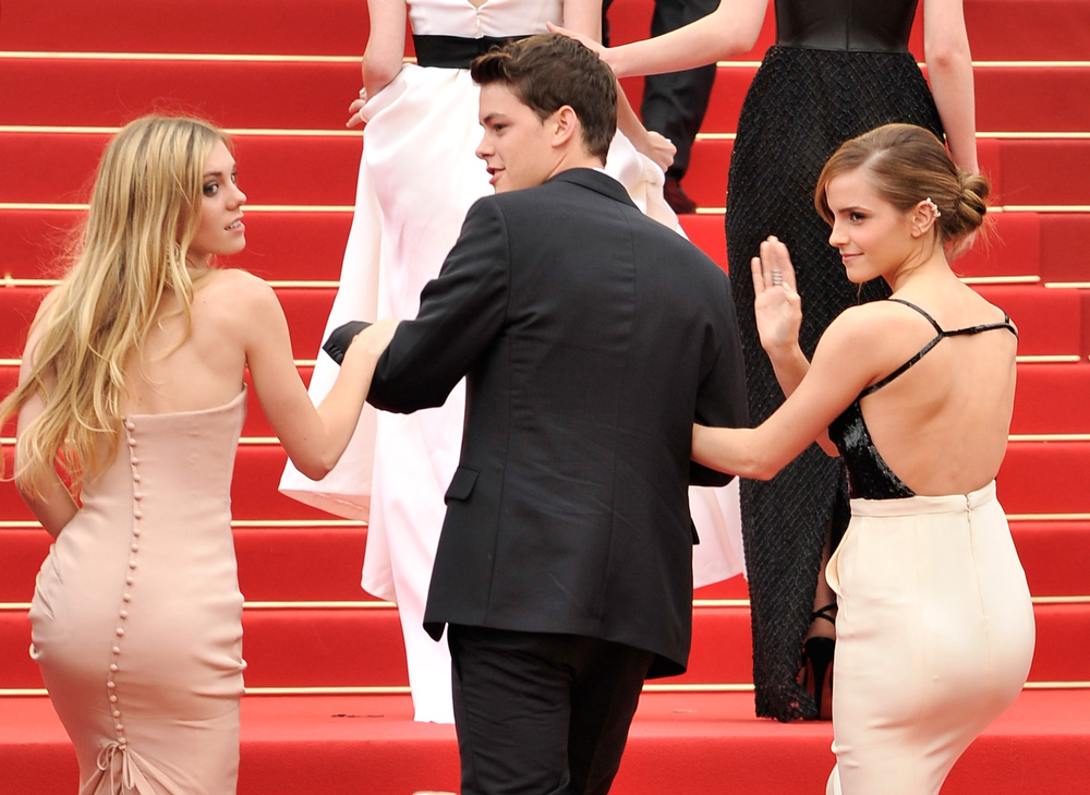 . Actress Claire Julien, actor Israel Broussard and actress Emma Watson attend \'The Bling Ring\' premiere during The 66th Annual Cannes Film Festival at the Palais des Festivals on May 16, 2013 in Cannes, France.  (Photo by Gareth Cattermole/Getty Images)