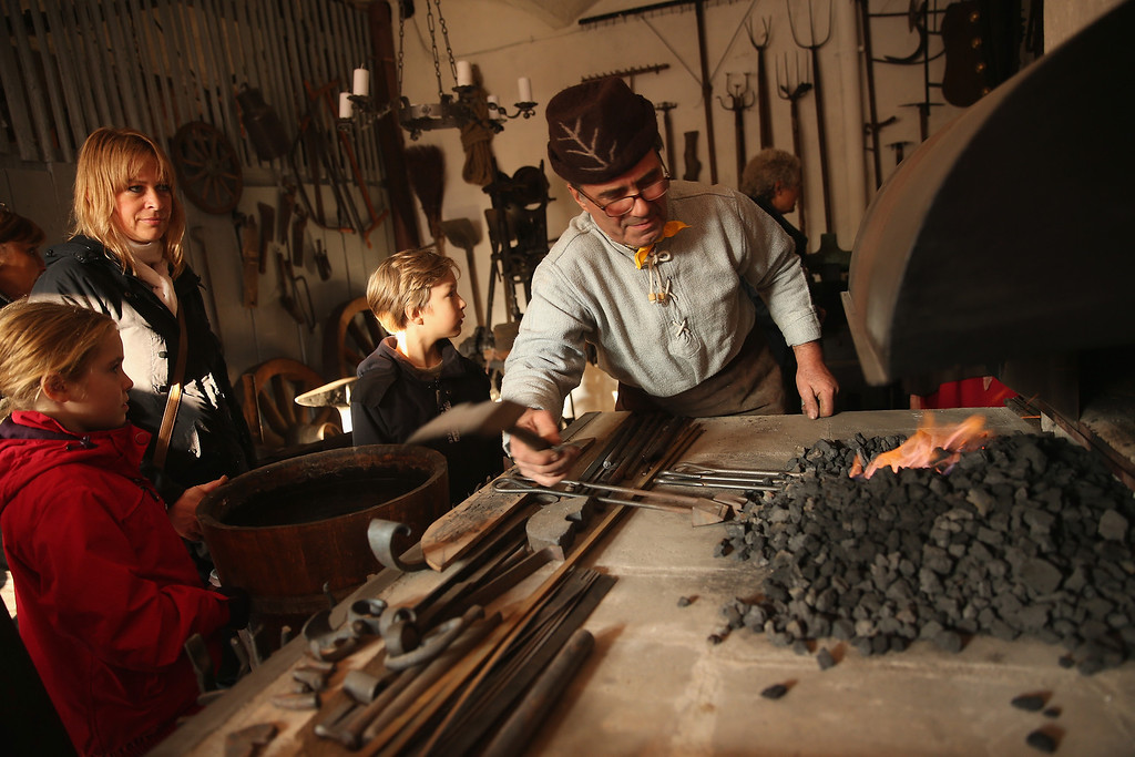 . Smith Eberhard Rotter heats up raw materials to make horse shoes in a recreated 1813 village in Liebertwolkwitz district during events to commemorate the 200th anniversary of The Battle of Nations on October 16, 2013 in Leipzig, Germany.  (Photo by Sean Gallup/Getty Images)