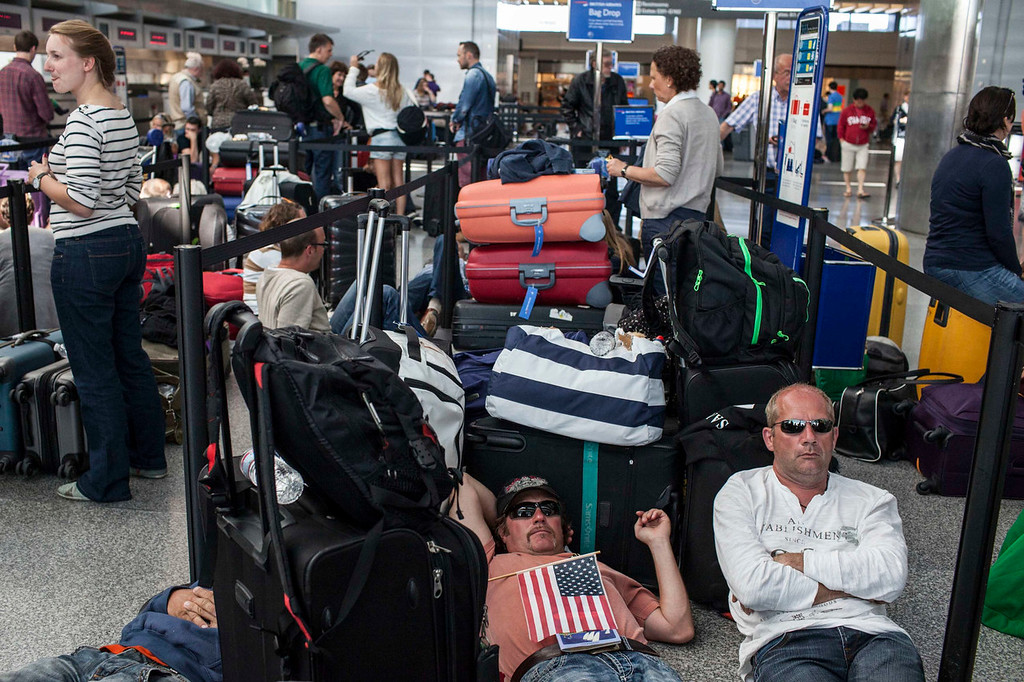 . Passengers wait for their delayed flight to London with British Airways after an Asiana Airlines Boeing 777 crashed and burst into flames as it landed at San Francisco International Airport in San Francisco, California July 6, 2013.  REUTERS/Jana Asenbrennerova