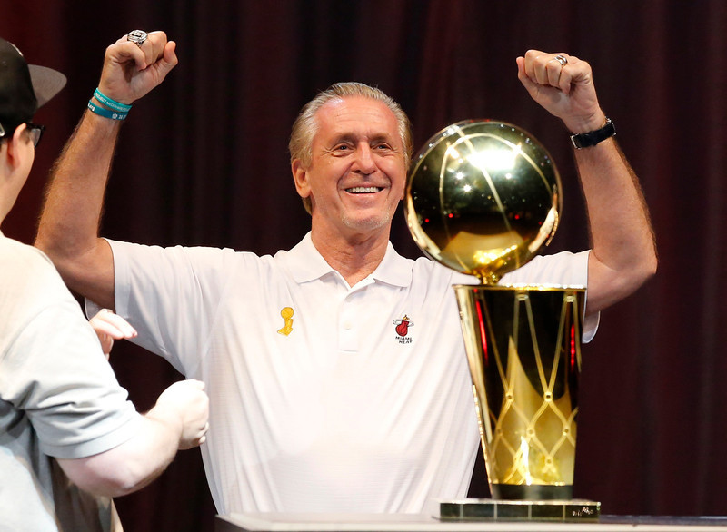 . Miami Heat President Pat Riley reacts after he was introduced during a celebration at the American Airlines Arena after the Heat\'s NBA Basketball Championship parade in Miami, Florida June 24, 2013.  REUTERS/Joe Skipper