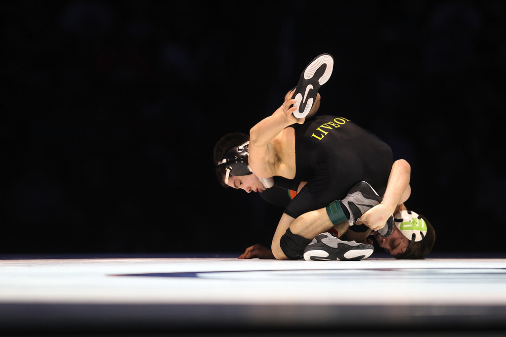 . Live Oak\'s Isaiah Locsin, top, wrestles Porterville\'s Mason Pengilly in the 120-pound championship match during the California Interscholastic Federation wrestling championships in Bakersfield, Calif., on Saturday, March 2, 2013. Pengilly won the match 5-3. (Anda Chu/Staff)