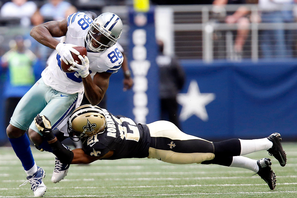 . Dallas Cowboys wide receiver Dez Bryant (88) breaks away from New Orleans Saints cornerback Patrick Robinson (21) to score a touchdown during the first half of an NFL football game on Sunday, Dec. 23, 2012, in Arlington, Texas. (AP Photo/Sharon Ellman)