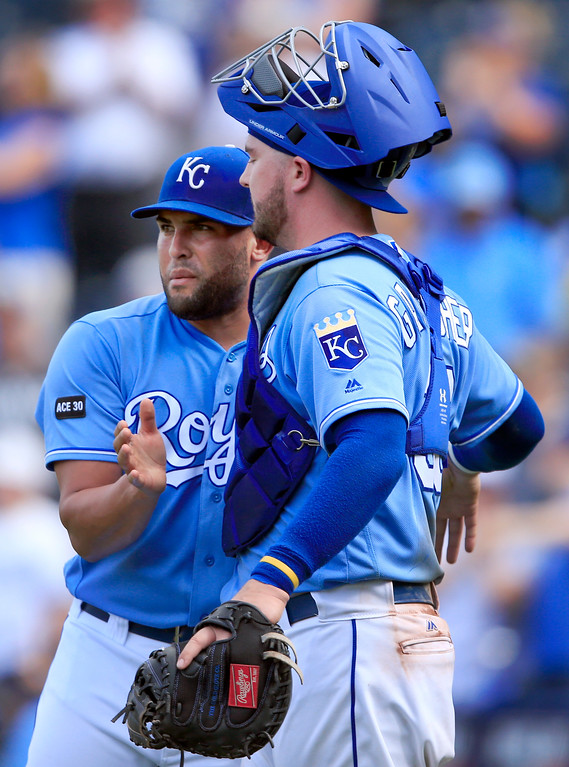 . Kansas City Royals relief pitcher Kelvin Herrera, left, celebrates with catcher Cam Gallagher, right, following a baseball game against the Cleveland Indians at Kauffman Stadium in Kansas City, Mo., Sunday, Aug. 20, 2017. The Royals defeated the Indians 7-4. (AP Photo/Orlin Wagner)