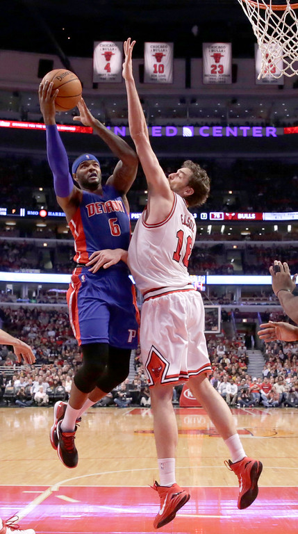 . Detroit Pistons forward Josh Smith (6) shoots over Chicago Bulls forward Pau Gasol during the second half of an NBA basketball game Monday, Nov. 10, 2014, in Chicago. The Bulls won 102-91. (AP Photo/Charles Rex Arbogast)