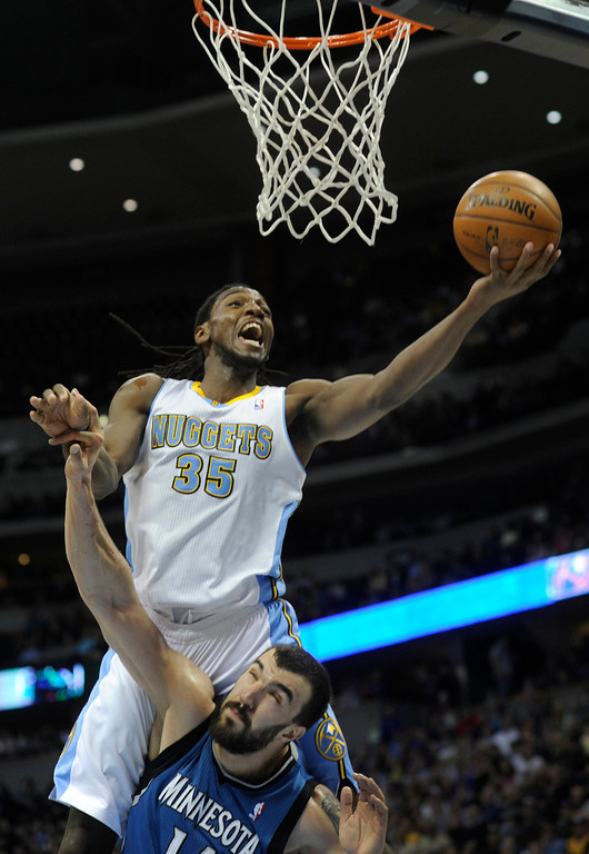 . Denver forward Kennth Faried (35) climbed over Wolves center Nikola Pekovic (14) for a shot in the second half. The Minnesota Timberwolves took a bite out of the Denver Nuggets winning 101-97 at the Pepsi Center Thursday night, January 3, 2013. Karl Gehring/The Denver Post