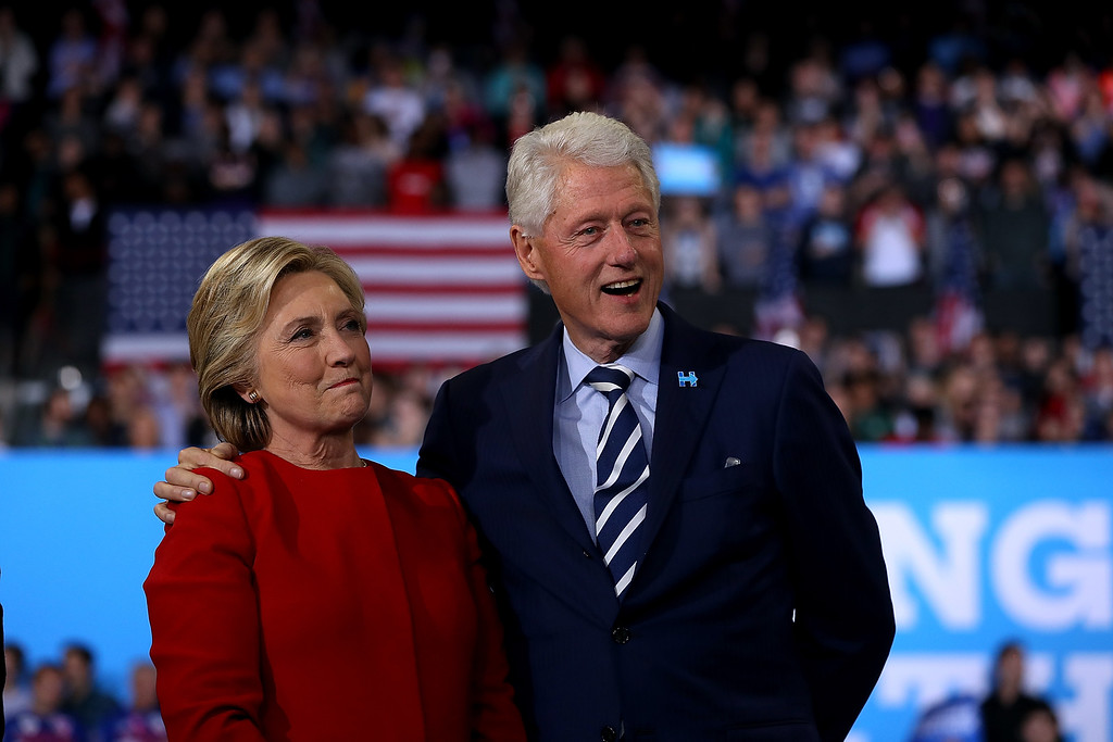 . RALEIGH, NC - NOVEMBER 08:  Democratic presidential nominee former Secretary of State Hillary Clinton (L) and her husband former U.S. President Bill Clinton look on during a campaign rally at North Carolina State University on November 8, 2016 in Raleigh, North Carolina. The midnight rally followed Clinton campaigning in Pennsylvania, Michigan and North Carolina in the lead up to today\'s general election.  (Photo by Justin Sullivan/Getty Images)