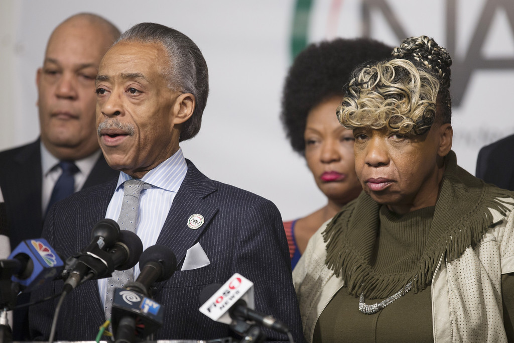 . NEW YORK, NY - DECEMBER 21: Rev. Al Sharpton (L), and Gwen Carr (R), Eric Garner\'s mother, during a press conference denouncing the shooting deaths of two New York Police Department (NYPD) officers at the National Action Network on December 21, 2014 in the Harlem neighborhood of New York City. The press conference follows the execution style shooting of officers, Wenjian Liu and Rafael Ramos in Brooklyn on December 20, 2014 where the suspect was apparently motivated by the deaths of Eric Garner and Michael Brown.  (Photo by Michael Graae/Getty Images)