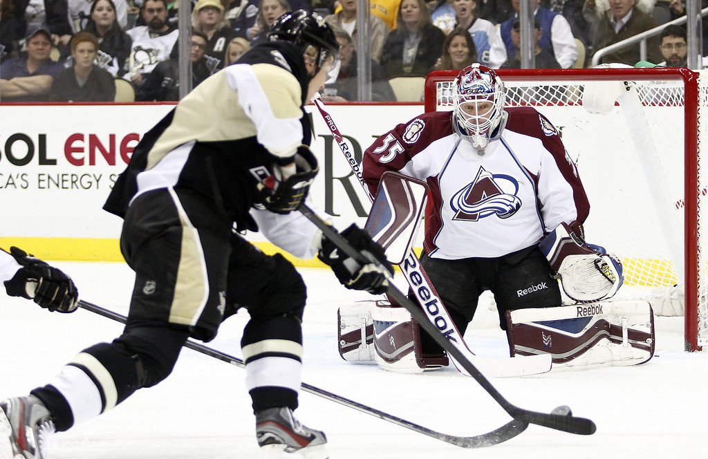 . Jean-Sebastien Giguere #35 of the Colorado Avalanche makes a save on Jussi Jokinen #36 of the Pittsburgh Penguins during the game at Consol Energy Center on October 21, 2013 in Pittsburgh, Pennsylvania.  (Photo by Justin K. Aller/Getty Images)