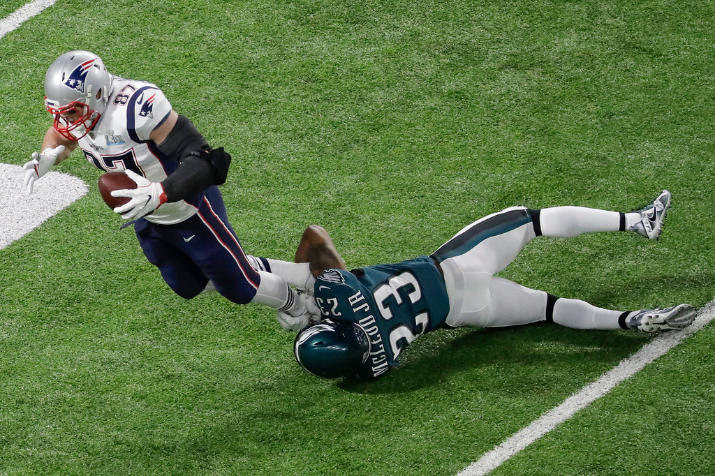 . New England Patriots tight end Rob Gronkowski (87) is tackled by Philadelphia Eagles free safety Rodney McLeod Jr. during the first half of the NFL Super Bowl 52 football game Sunday, Feb. 4, 2018, in Minneapolis. (AP Photo/Eric Gay)