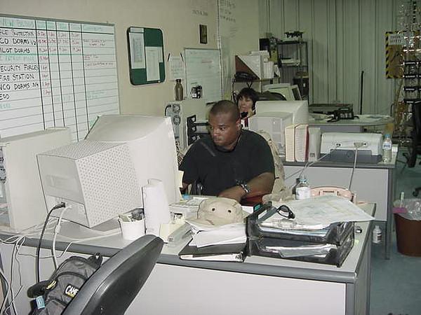 Chuck at his desk.JPG