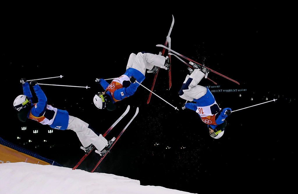 . In this multiple exposure photo, Seo Jung-hwa, of South Korea, jumps during the women\'s moguls finals at Phoenix Snow Park at the 2018 Winter Olympics in Pyeongchang, South Korea, Sunday, Feb. 11, 2018. (AP Photo/Gregory Bull)