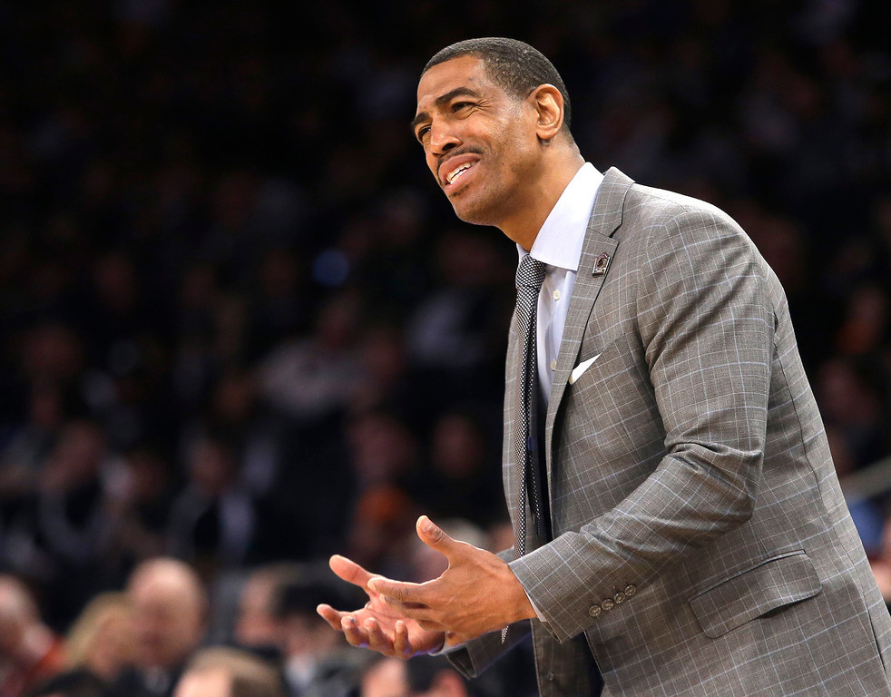 . Connecticut head coach Kevin Ollie instructs his team in the first half of a regional final against Michigan State at the NCAA college basketball tournament on Sunday, March 30, 2014, in New York. (AP Photo/Frank Franklin II)