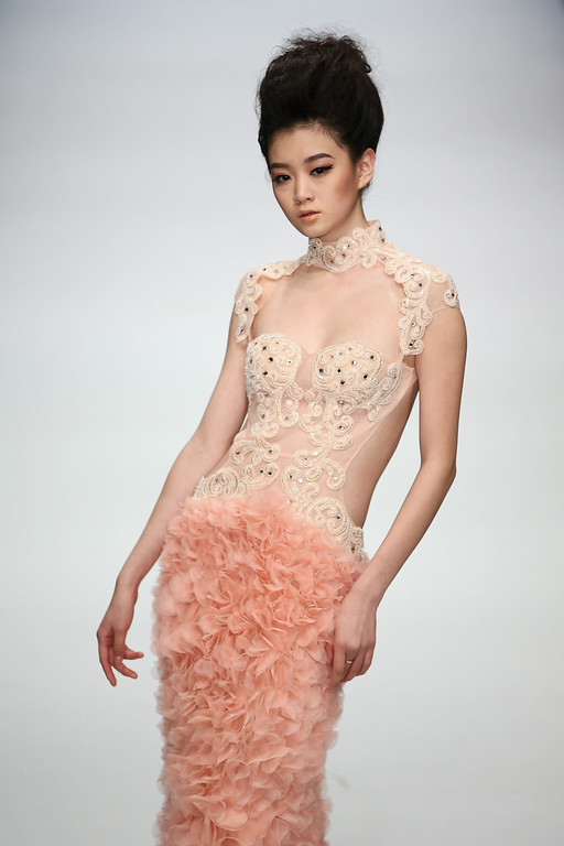 . A model showcases designs by Chinese designer Zhang Jingjing on the runway at Zhang Jingjing Haute Couture Collection show during Mercedes-Benz China Fashion Week Spring/Summer 2014 at 751 D-PARK Central Halll on October 26, 2013 in Beijing, China.  (Photo by Feng Li/Getty Images)