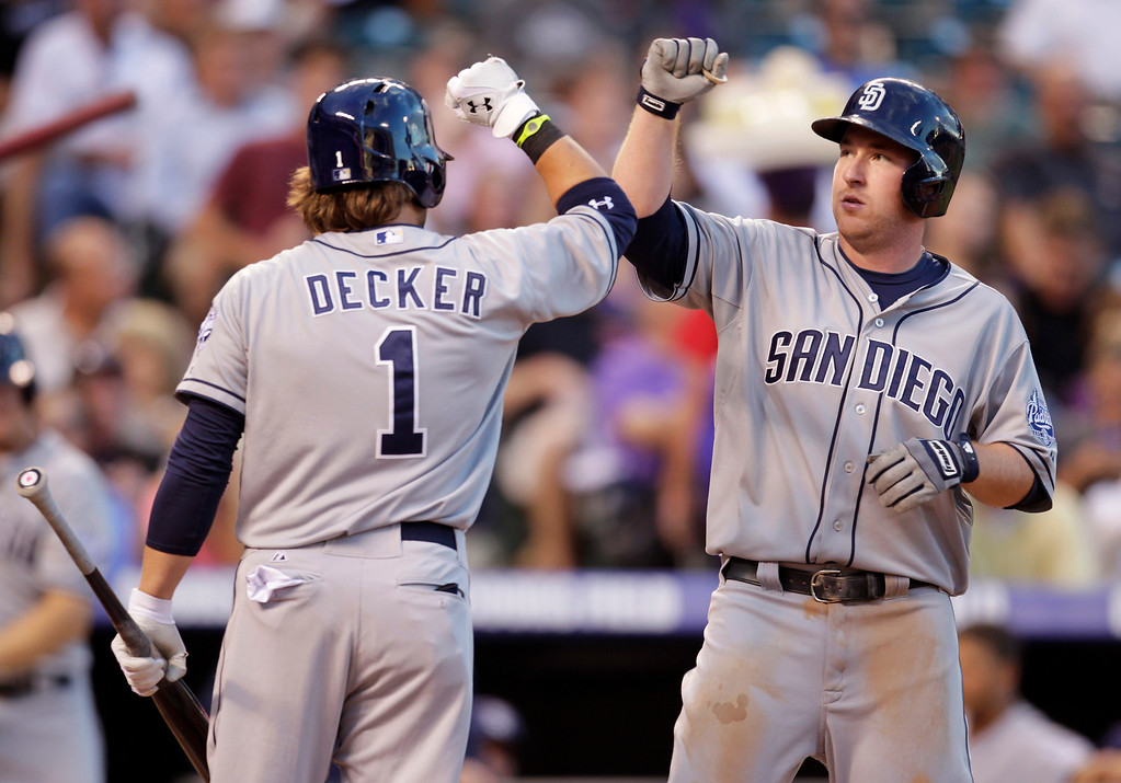 . San Diego Padres\' Jeff Decker (1) congratulates Padres\' Jedd Gyorko after Gyorko\'s solo home run in the third inning of a baseball game against the Colorado Rockies in Denver on Tuesday, Aug. 13, 2013.(AP Photo/Joe Mahoney)