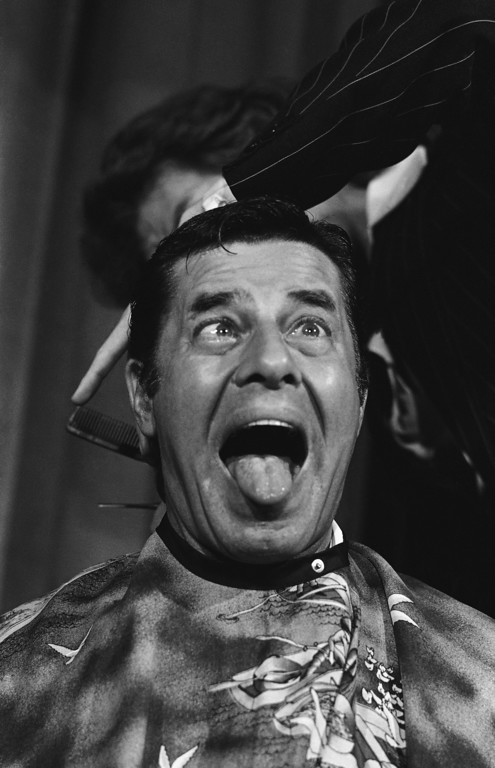 . File - Comedian Jerry Lewis cuts up during that might be the most expensive haircut in history.   Lewis, chairman for the Muscular Dystrophy Association., was given a $250,000.  The promissory note stipulating that he get his hair trimmed.   The money goes to the Muscular Dystrophy Assoc., and was he gets his given by Ray Kroc, owner of the San Diego Padres baseball club.    Lewis had his hair cut at Hollywood on Oct. 16, 1977, where he spoke to a group of campus leaders from across the country.   (AP Photo/Phil Sandlin)