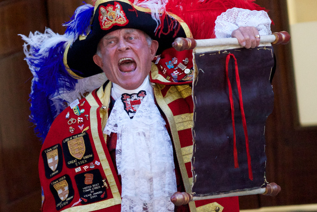 . A Town Crier reads an announcement about the birth of a baby boy at 4.24pm to Prince William and Catherine, Duchess of Cambridge, outside the Lindo Wing of St Mary\'s Hospital in London, on July 22, 2013. Prince William\'s wife Kate gave birth to a baby boy today, providing Britain\'s royal family with a future king in an event that had been anticipated around the world, Kensington palace said.    ANDREW COWIE/AFP/Getty Images