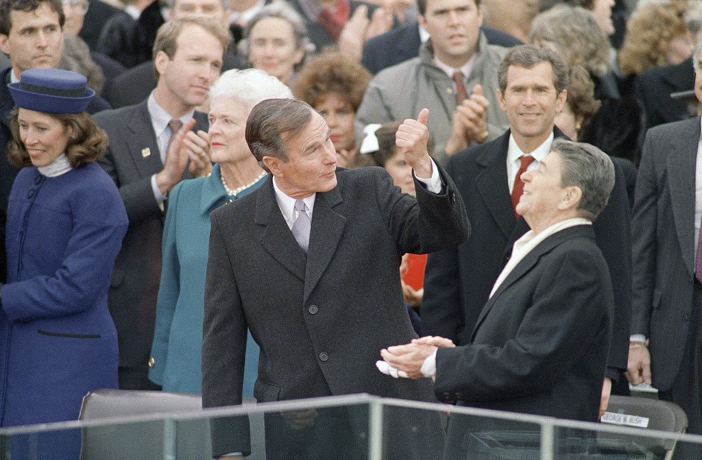 . President-elect George Bush gives President Ronald Reagan a thumbs up as Reagan reacts prior to Bush being sworn in as the 41st president of the United States outside the Capitol, Jan. 20, 1989, in Washington. Behind Reagan is Bush\'s son George W. Bush. (AP Photo/Ron Edmonds)