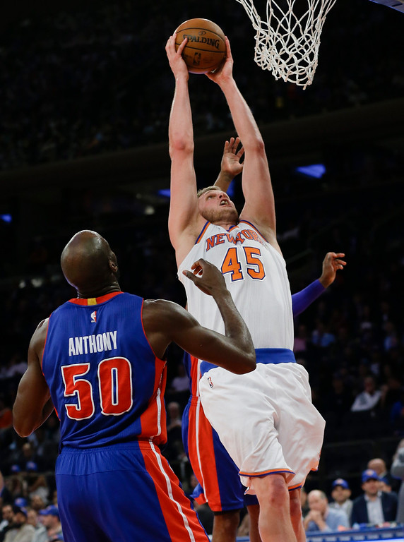 . New York Knicks\' Cole Aldrich (45) drives past Detroit Pistons\' Joel Anthony (50) during the second half of an NBA basketball game Wednesday, April 15, 2015, in New York. The Pistons won 112-90. (AP Photo/Frank Franklin II)