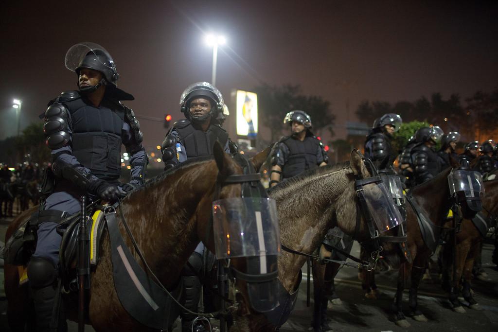 . Anti riot police officers patrol after clashes erupted during a protest against bus fare price hikes June 20, 2013 in Rio de Janeiro, Brazil.  (Photo by Rafael S. Fabres/Getty Images)