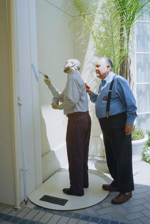 """. Comedian Jonathan Winters asks: \'\'Are you finished\'\'? as he takes a tour around a look-a-live garden statue \""""Weekend Painter,\"""" by J. Seward Johnson Jr., at a Beverly Hills hotel on Monday, May 6, 1997. (AP Photo/Damian Dovarganes)"""